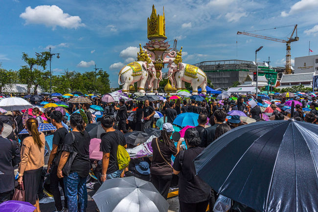 Crowds gather at Sanam Luang to sing the Thai Royal Anthem. Adult Architecture Bangkok Ceremony Crowd Day Horizontal King Bhumipol Adulyadet Large Group Of People Multi Colored Outdoors People Real People Sky Thailand
