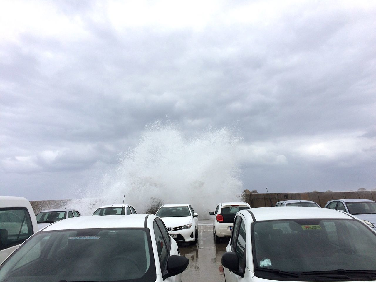 Car Parking Parking Lot Coast Stormy Weather Sea Sea And Sky Waves Ocean Spray Cloud - Sky Day No People Noise Roaring Many Objects White Car Power Of Nature