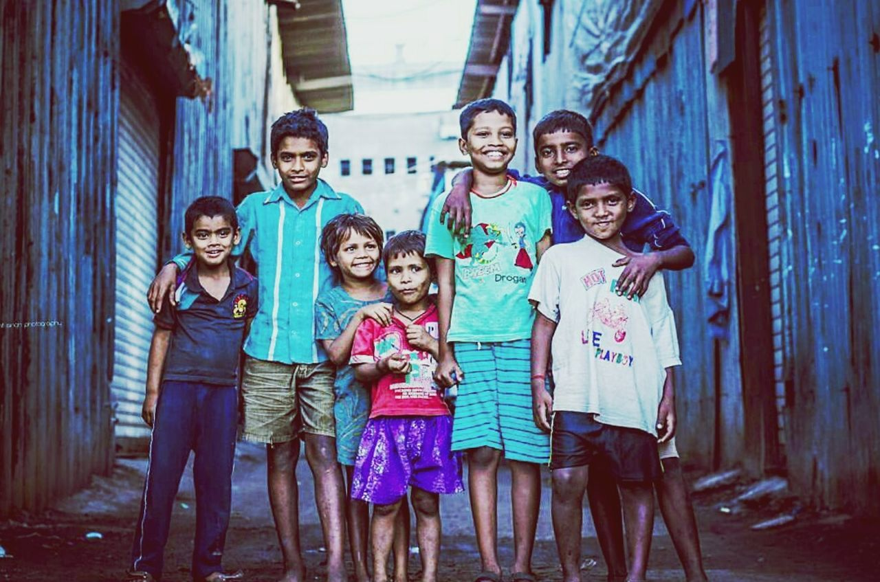 Beautifully Organized Child Girls Family Looking At Camera Portrait Boys Happiness Childhood Mother Togetherness Father Offspring Females Lifestyles Smiling Males  People Beautiful People Adult Group Of People