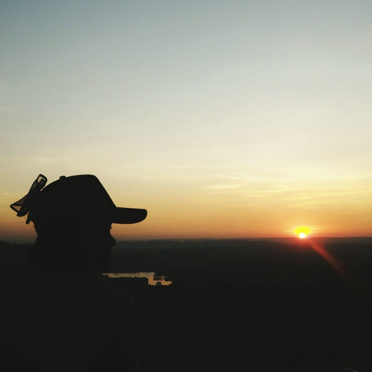 sunset, silhouette, sky, standing, sun, outdoors, nature, one person, real people, clear sky, beauty in nature, day, people