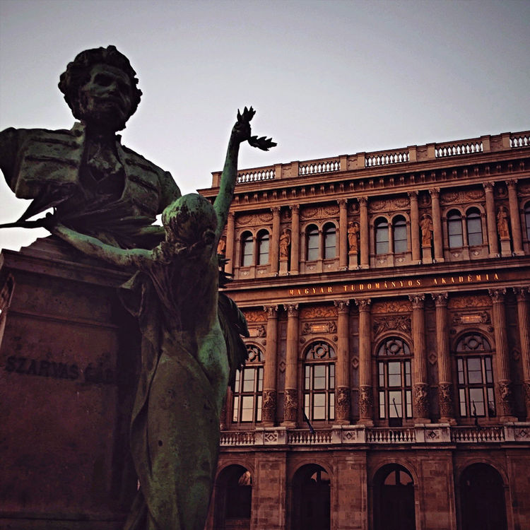 Architecture Art Budapest Building Exterior Built Structure Clear Sky Creativity Famous Place History Human Representation Hungarian Scientific Academy Hungary Magyar Tudományos Akadémia Science Sculpture Sky Statue Travel Destinations