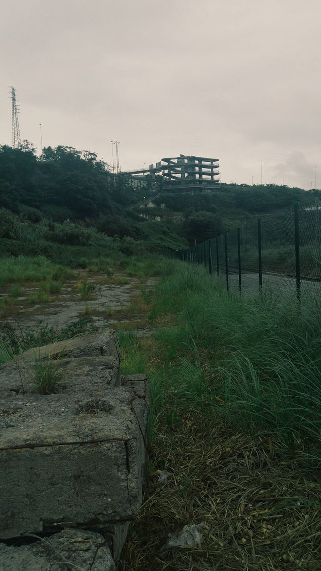 Urban construction in Vizcaya Beauty In Nature Built Structure Cloud Cloud - Sky Cloudy Day Field Grass Grassy Green Color Growth Landscape Nature No People Non-urban Scene Outdoors Overcast Plant Remote Rural Scene Scenics Sky Tranquil Scene Tranquility Vizcaya