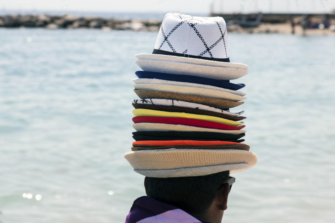 Beach Beachphotography Close-up Day Hats Leisure Activity Lifestyles One Person Outdoors Real People Sea Seller Water