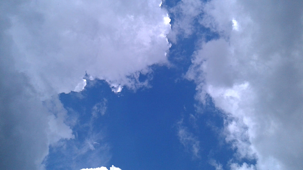 Clouds part after a storm to reveal a vivid blue sky. After The Rain Backgrounds Beauty In Nature Blue Cloud - Sky Clouds And Sky Day Low Angle View Nature No People Outdoors Scenics Sky Sky Only Tranquility Weather