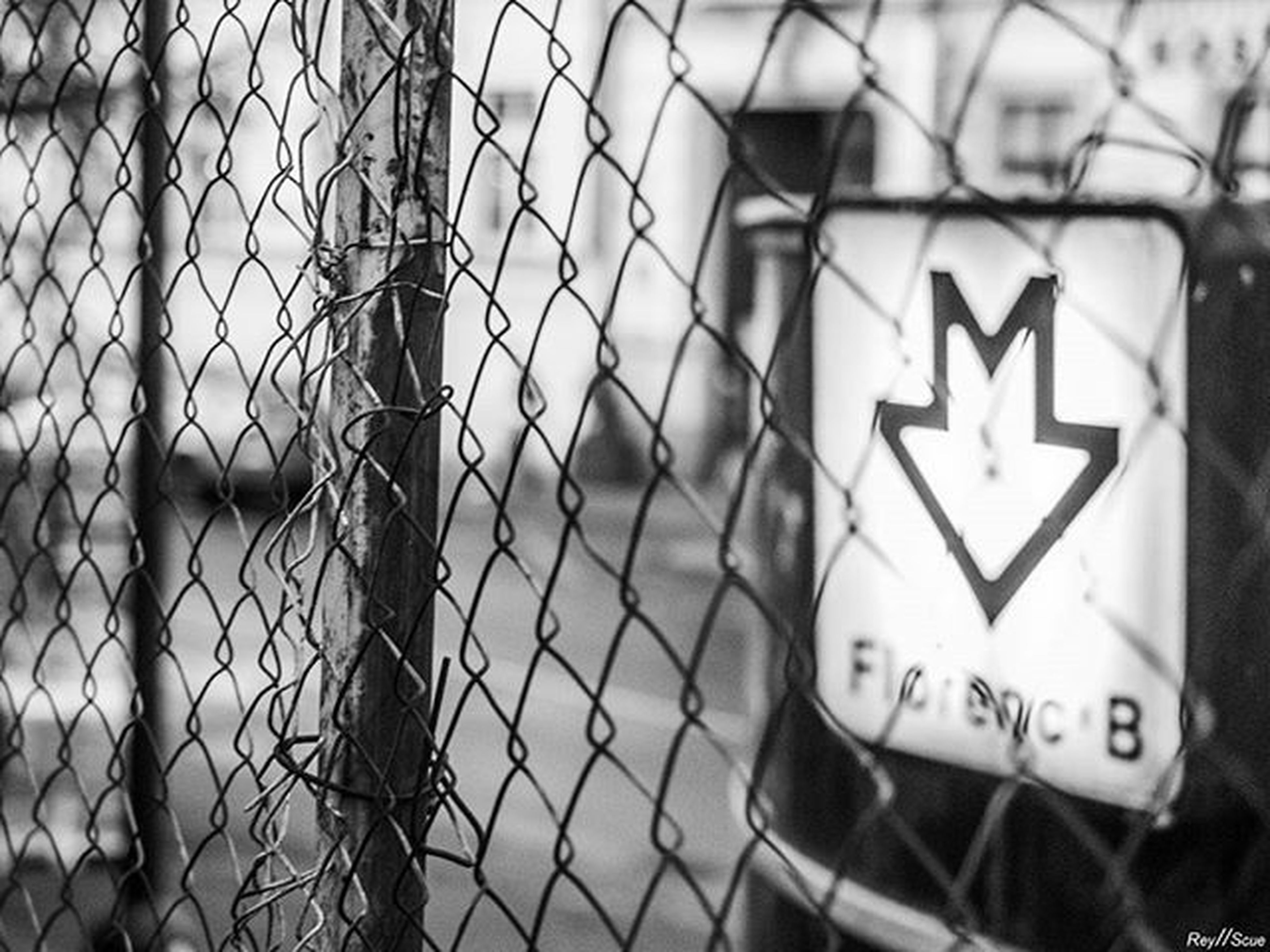 text, communication, western script, focus on foreground, close-up, safety, protection, security, sign, day, metal, guidance, building exterior, no people, built structure, information sign, outdoors, architecture, fence, chainlink fence