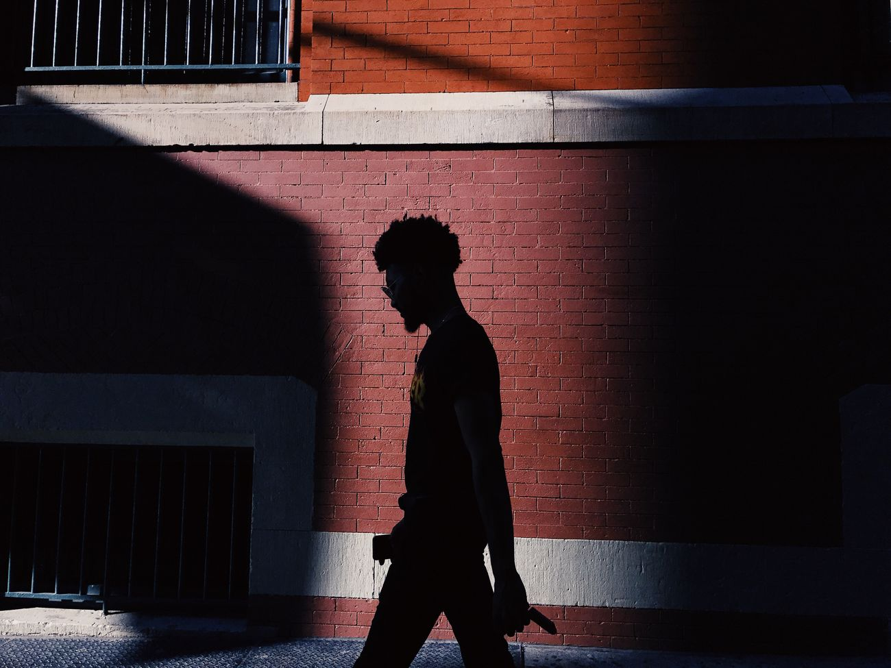 The Street Photographer - 2017 EyeEm Awards IPhone VSCO Shadow One Person Real People Built Structure Architecture Sunlight Side View Lifestyles Standing Men Full Length Day Outdoors People