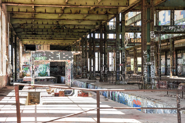 Interior shell of the old ruins of the South Fremantle Power Station with street art in North Coogee, Western Australia Abandoned Architecture Beams Broken Windows Building Colorful Concrete Empty Graffiti Industrial North Coogee Power Station Ruins South Fremantle Steel Street Art Structural Steel Tagging Urban Art Vacant Vandalism Warehouse Western Australia Windows Youth Culture