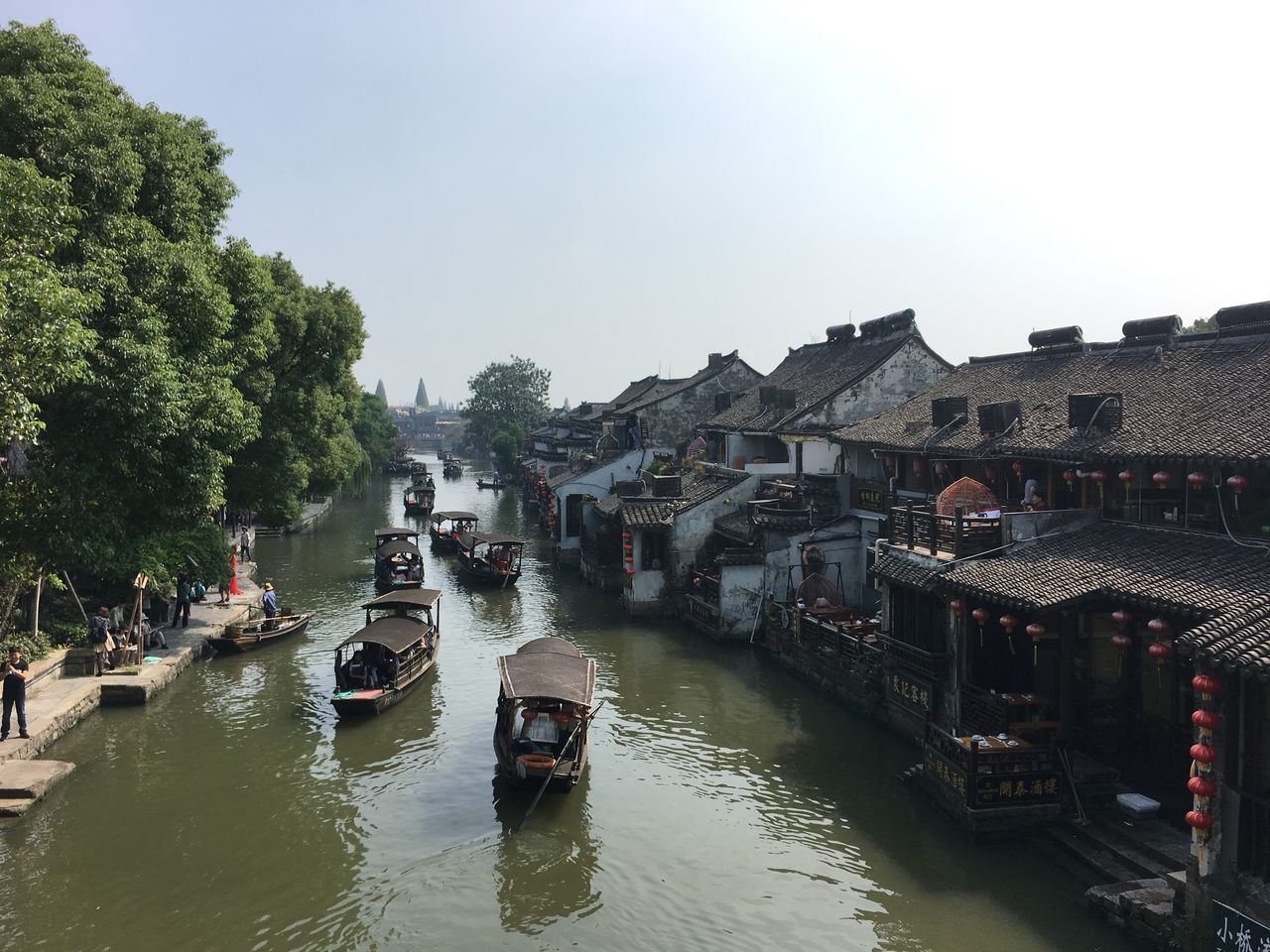China Watertown Xitang Fresh On Eyeem  Nautical Vessel Transportation Architecture Boat Building Exterior Built Structure Water Tree Moored Mode Of Transport Canal Waterfront High Angle View Clear Sky River Day Diminishing Perspective Vanishing Point Sky Riverbank