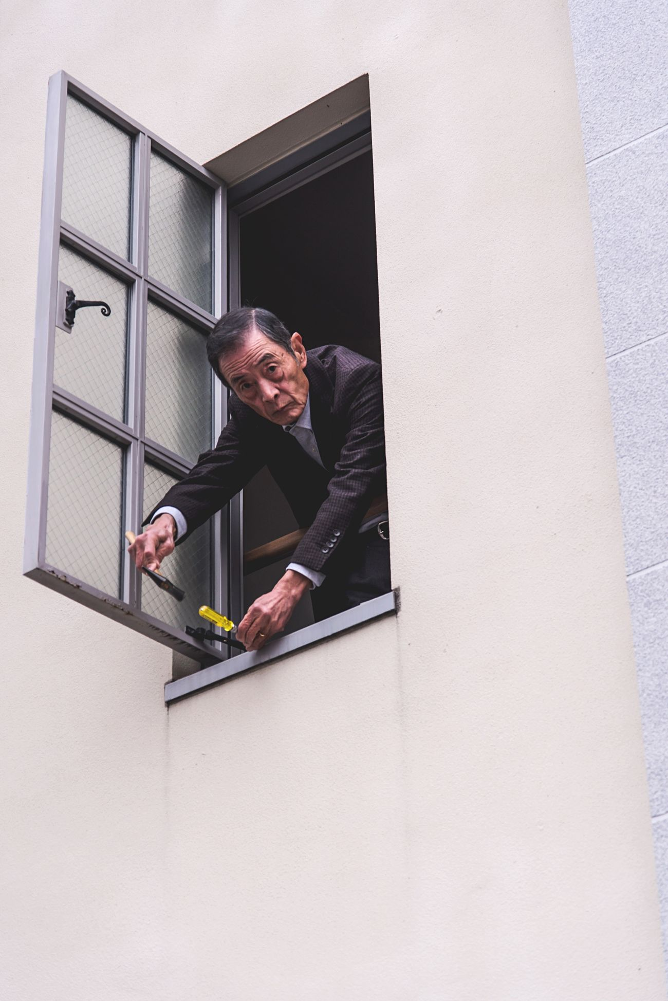 The man repairing the window Only Men One Person Minimal Minimalist Portrait Minimalism Street City Street Japan OSAKA Streetphotography