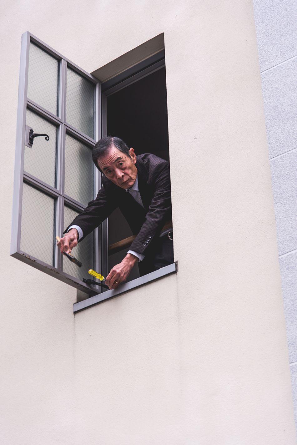 The man repairing the window Only Men One Person Minimal Minimalist Portrait Minimalism Street City Street Japan OSAKA Streetphotography