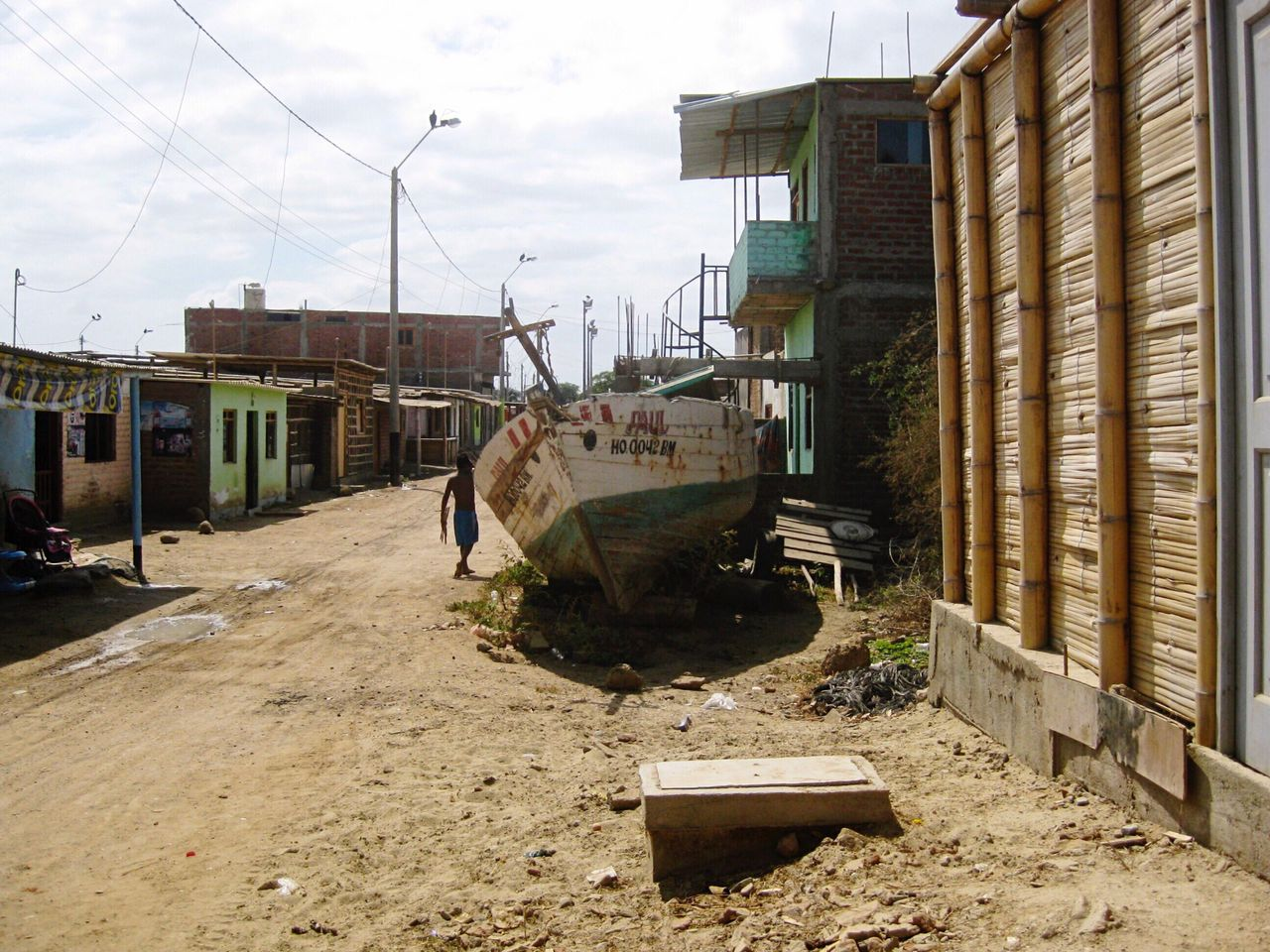 After the flood Live For The Story The Street Photographer - 2017 EyeEm Awards The Photojournalist - 2017 EyeEm Awards Streetphotography Built Structure Architecture Damaged Destruction Day Outdoors Boat Scenics Daily Life in Mancora , Peru