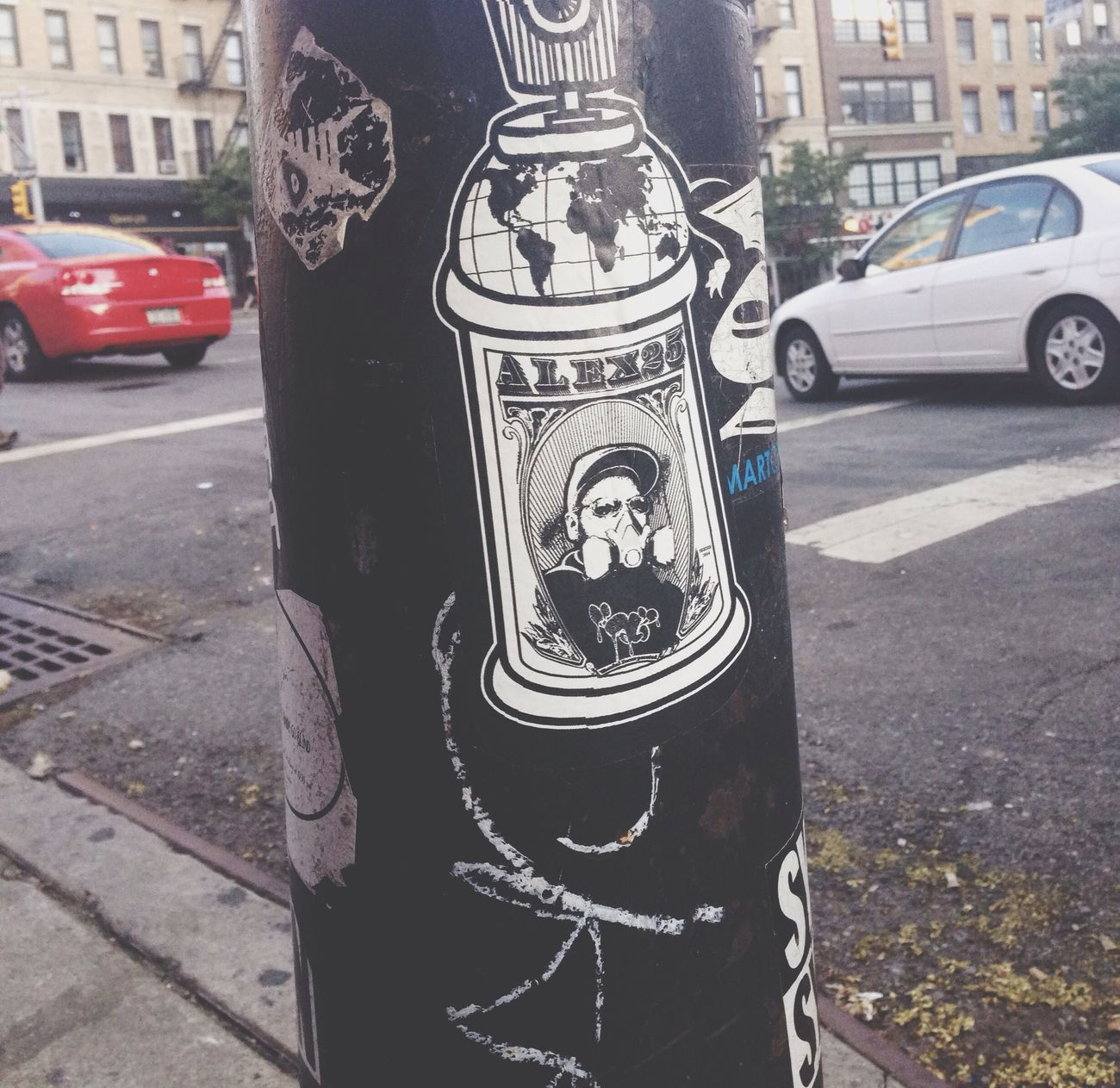 the world in a spray can. New York Street Art Sticker Travel Photography