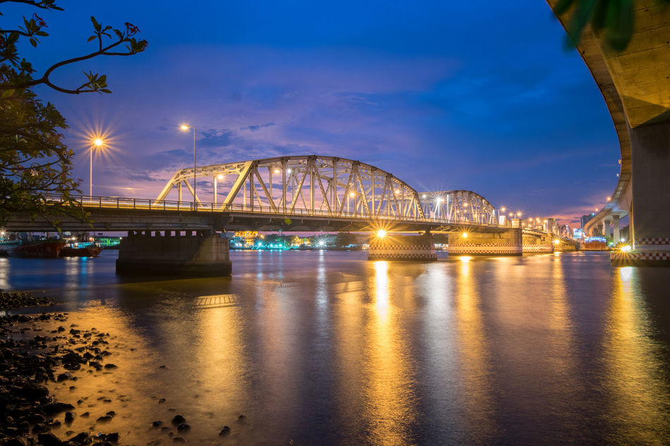 Bangkok bridge in bangkok , Thailand at twilight Architecture Bangkok Bangkok Thailand. Blue Bridge Built Structure City Cloud Connection Engineering Illuminated Nature No People Outdoors Reflection River Sky Sun Sunset Tranquility Water