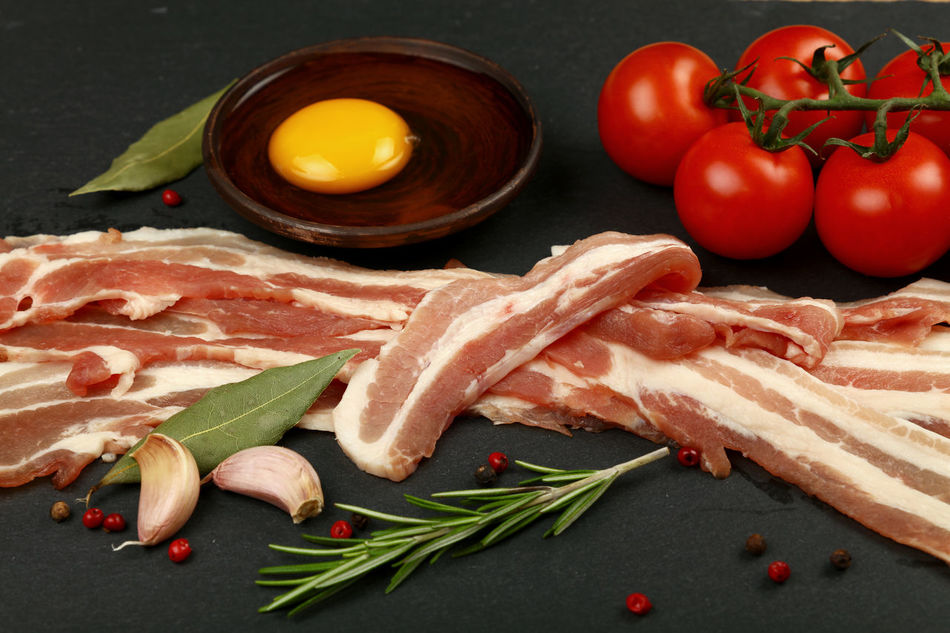 Cooking English breakfast, egg, bacon, red cherry tomatoes on black slate board Bacon Bacon! Bacon&egg Breakfast Cherry Tomatoes Close-up Cooking Cuisine Day Egg Yolk English Breakfast Food Food And Drink Food And Drink Meat Pork Preparing Food Raw Raw Food Red Rosemary Slate Slices Tomato Vegetable