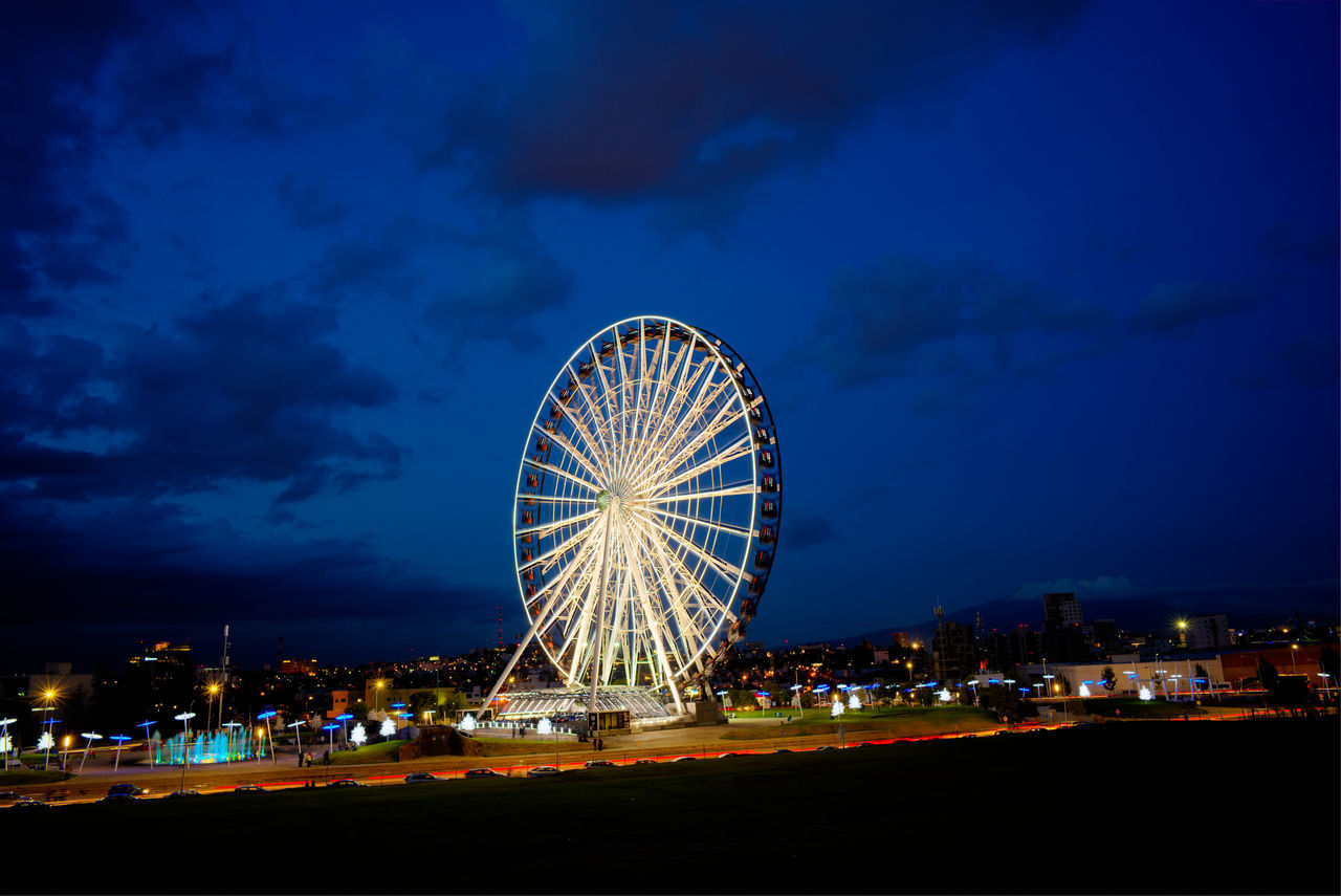 Amusement Park Bridge - Man Made Structure City Cityscape Cloud - Sky Dusk Ferris Wheel Illuminated Night No People Outdoors Sky Travel Destinations Wheel