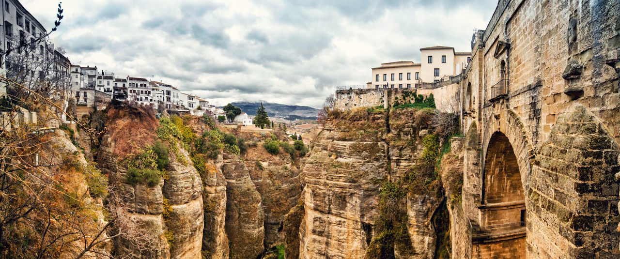 Bridge and Picturesque view of Ronda city. Province of Malaga, Andalusia, Spain Ancient Architecture Andalusia Bridge Bridge - Man Made Structure Cliffs Cloud - Sky Costa Del Sol Famous Place History Houses Landmark Landscape Malaga Mountain Nature Outdoors Panorama Panoramic Picturesque Village Rocky Mountains Ronda Spain SPAIN Town Travel Destinations Village