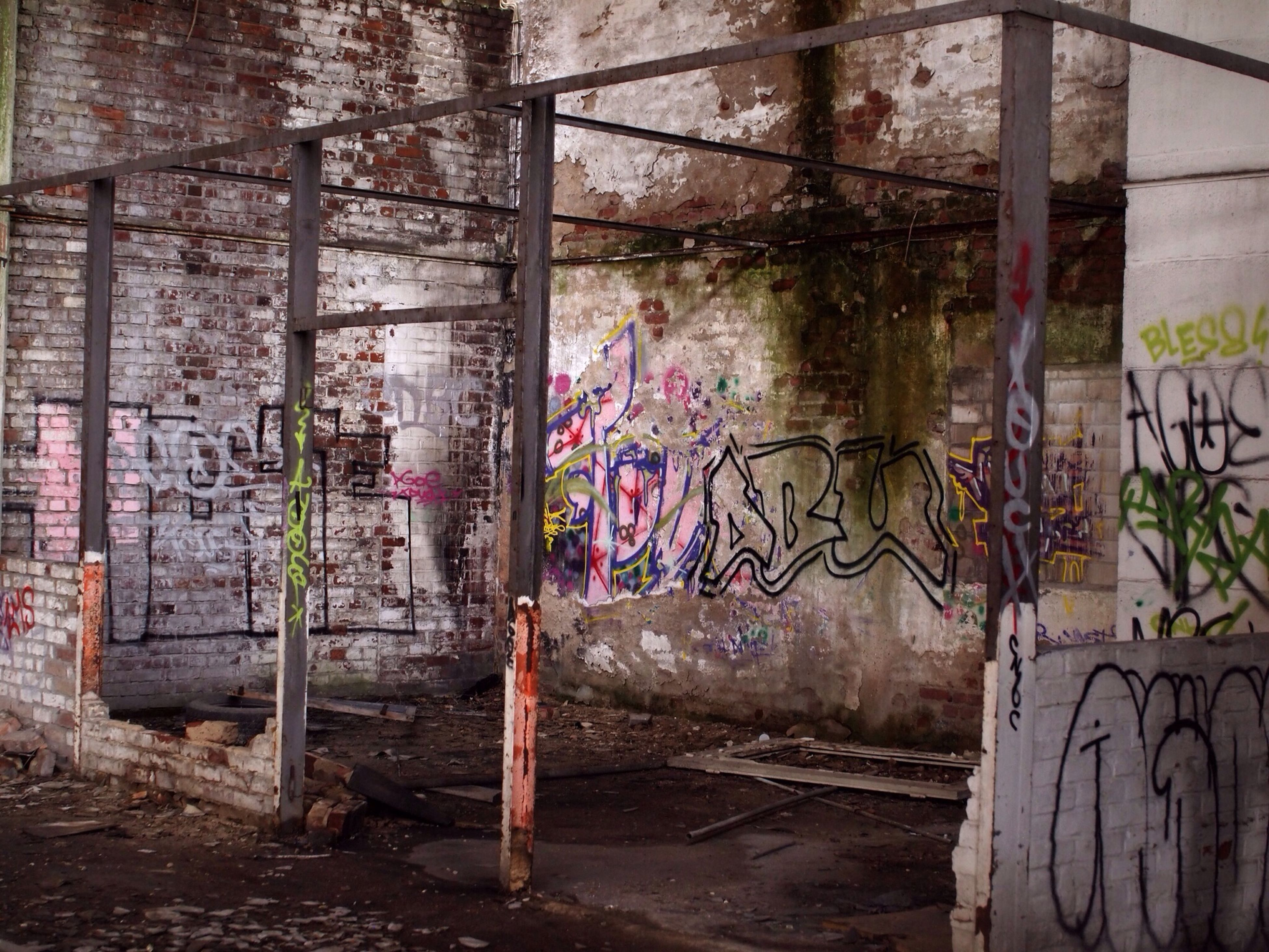 graffiti, built structure, wall - building feature, architecture, abandoned, building exterior, damaged, old, obsolete, deterioration, weathered, wall, run-down, brick wall, window, messy, bad condition, day, art, no people