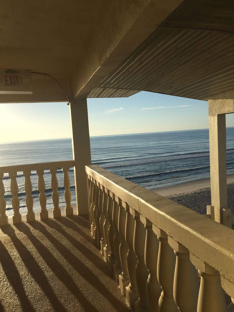 sea, horizon over water, water, railing, sunlight, beach, scenics, nature, tranquil scene, shadow, tranquility, built structure, architecture, no people, beauty in nature, day, sky, outdoors, clear sky