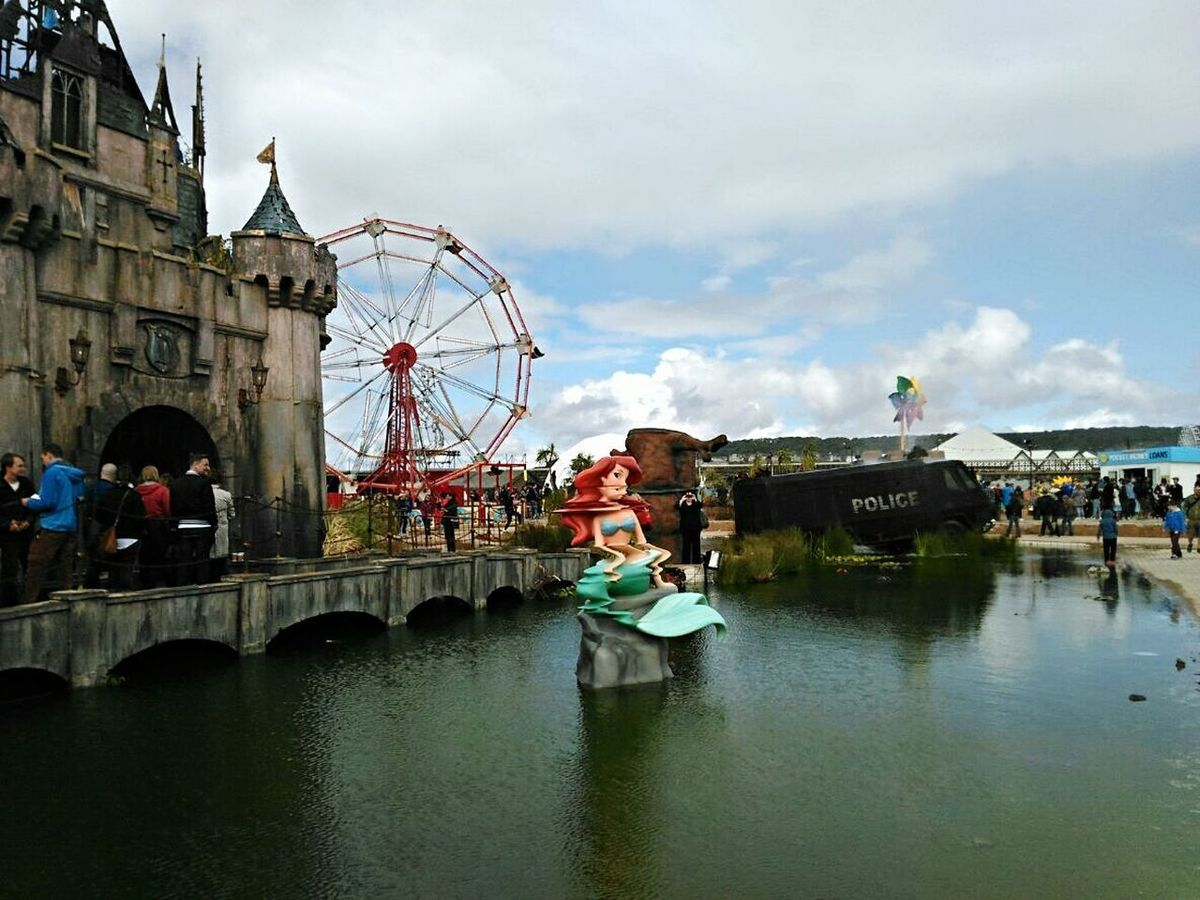 Ferris Wheel Travel Destinations Bridge - Man Made Structure Rooftop Disney Castle Castle Disney Castle Ruin Travel Architecture Banksyart England🇬🇧 Reino Unido Dismaland Banksy Dismaland® United Kingdom Inglaterra Leisure Activity Arts Culture And Entertainment Mermaid Ariel The Little Mermaid! Ariel Wheel Cloud - Sky