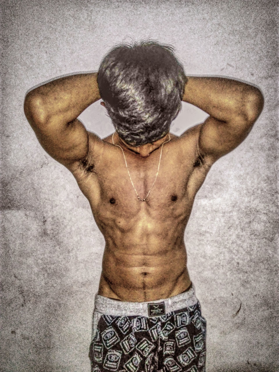 rear view, shirtless, human arm, one man only, muscular build, human back, human body part, only men, studio shot, one person, the human body, back, strength, men, gray background, adult, standing, adults only, hands behind head, people, macho, human hand, indoors, close-up, masculinity, sportsman, athlete, day