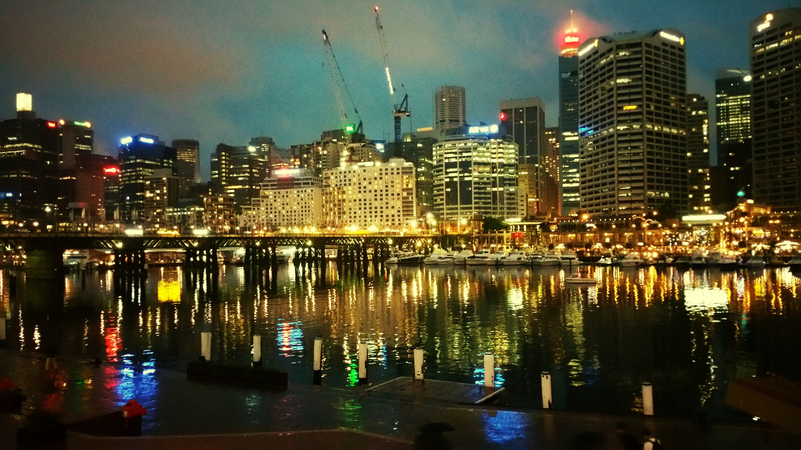 illuminated, city, building exterior, night, skyscraper, water, architecture, built structure, reflection, cityscape, waterfront, modern, urban skyline, river, office building, financial district, tall - high, tower, skyline, sky