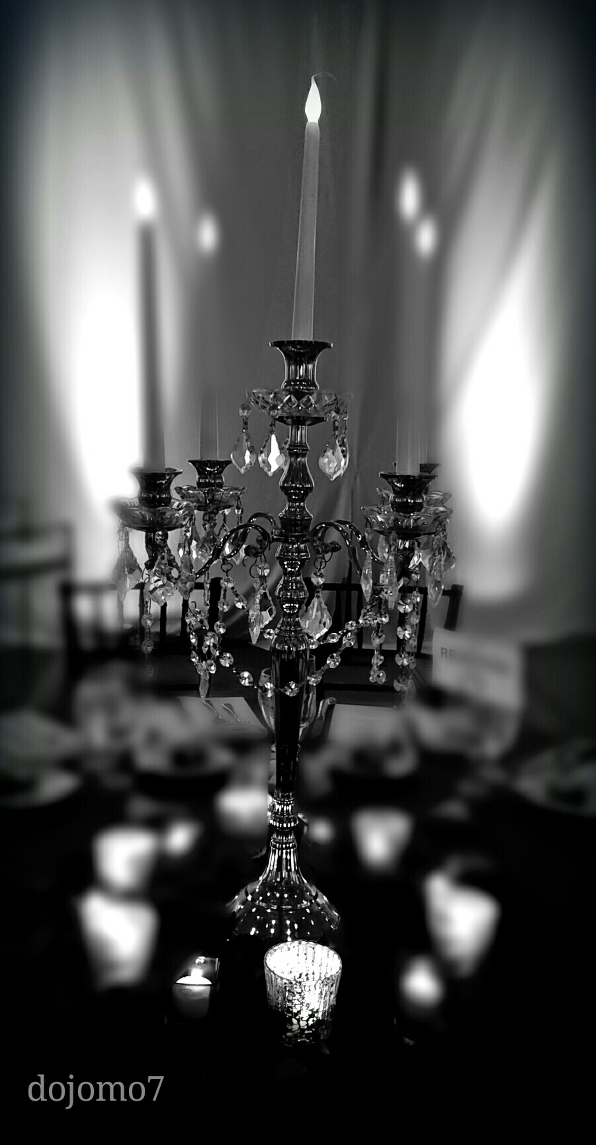 illuminated, lighting equipment, indoors, hanging, chandelier, decoration, electricity, night, focus on foreground, close-up, decor, ceiling, low angle view, electric light, electric lamp, glowing, light - natural phenomenon, no people, home interior, built structure