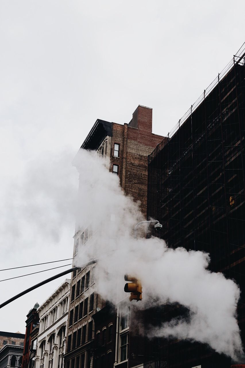 architecture, built structure, smoke - physical structure, building exterior, day, outdoors, sky, no people, city