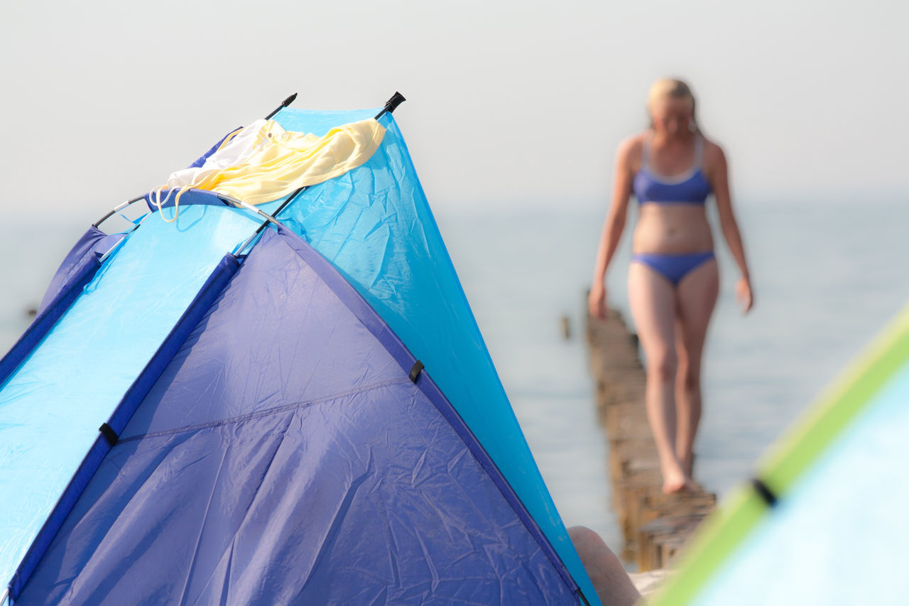 Girl at the beach Baltic Sea Beauty Day Graal-Müritz Leisure Activity Lifestyles Nature One Person Outdoors Real People Sea Summer Sun Shield Swimwear Tent Water Young Women Live For The Story
