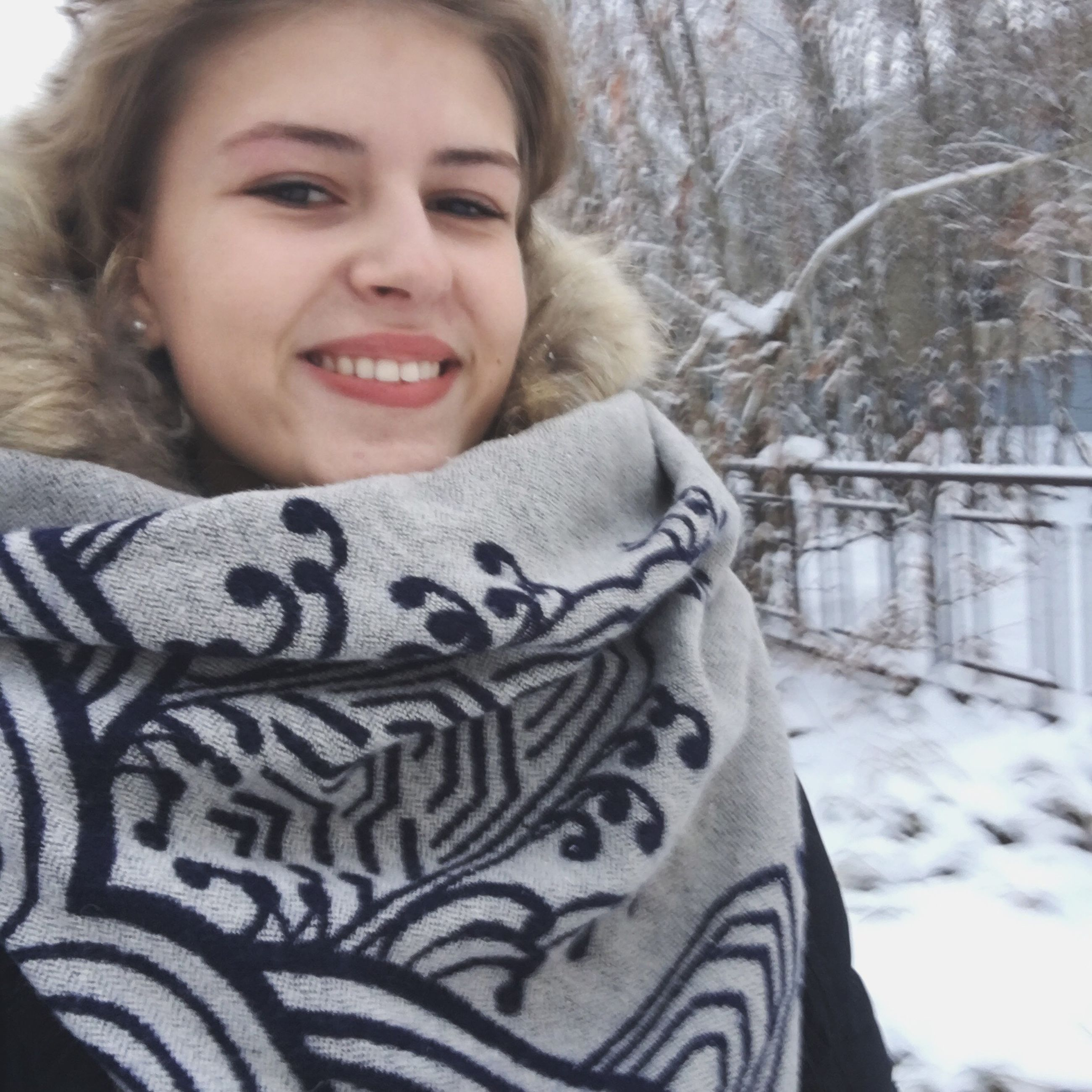 winter, cold temperature, snow, real people, one person, weather, smiling, young women, warm clothing, young adult, leisure activity, lifestyles, day, happiness, tree, outdoors, nature, women, cheerful, beauty in nature, beautiful woman, close-up