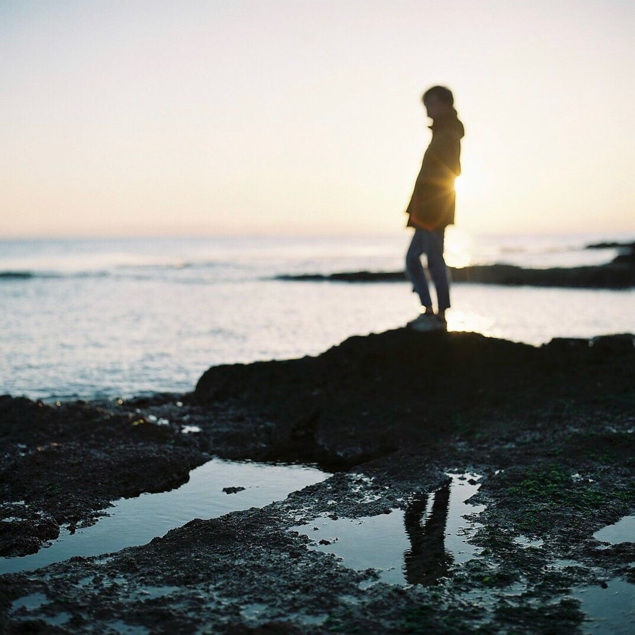 Sea Full Length One Person Rock - Object Horizon Over Water Standing Water Tranquility Beach Outdoors Scenics Japan Sunset Beauty In Nature One Woman Only Tranquil Scene Leisure Activity Clear Sky Real People Sky