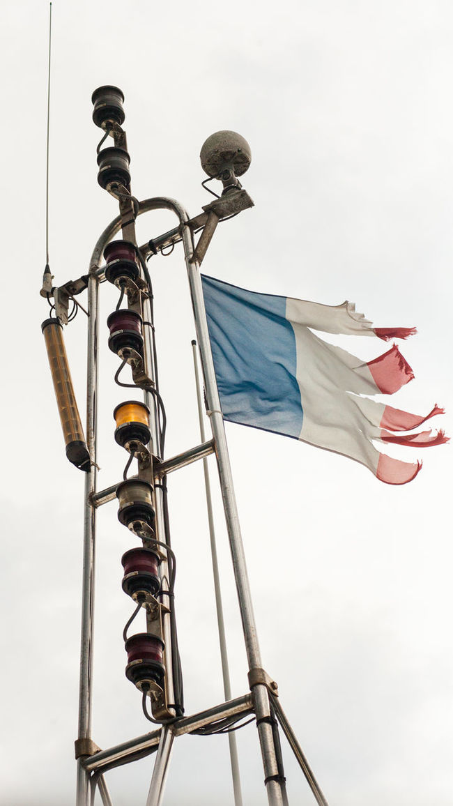 Boat Day Flag French French Flag Low Angle View Mast No People Outdoors Patriotism Pirate Sky Vertical