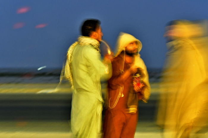 Arabic men standing in the street Arabs Adult Adults Only Arabic Blurred Motion Bonding Couple - Relationship Day Leisure Activity Lifestyles Love Men Menswear Nature Outdoors Pakistanoi7 People Real People Sky Standing Togetherness Two People Women Yellow Young Adult
