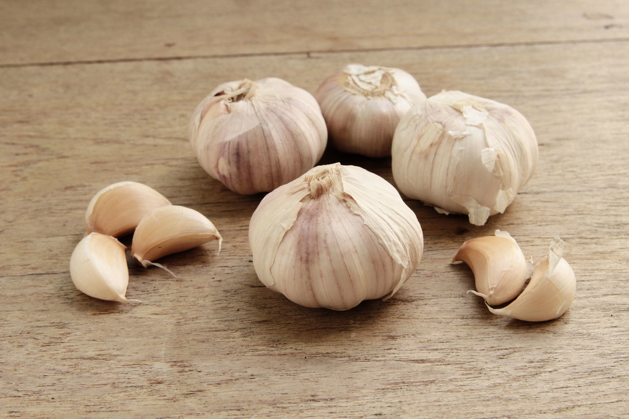 Organic garlic whole and cloves on the wooden background Close-up Food Food And Drink Garlic Garlic Bulb Garlic Clove Healthy Eating No People