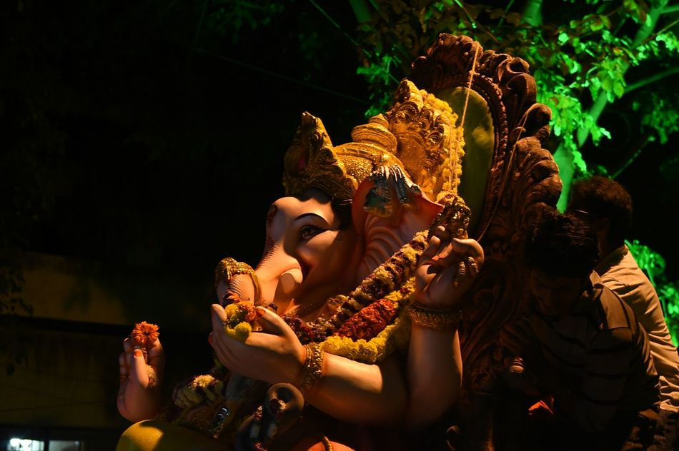 Ganapathi bappa mowrya Ritual Darkness And Light Lihht In The Distant Light And Shadow Glowing Through The Dark India Festival Glare Lights