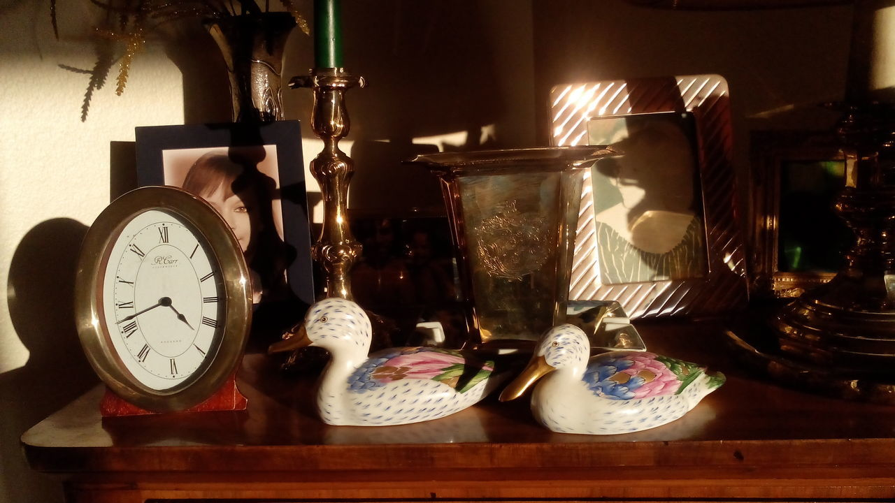 memories of a grandmother, arrangment with photo of the grandchild, decorative items and a clock Clock Decoration Family Heirloom Home Indoors  Lifetime Melancholy Memories Objects Old Age Old Fashioned Old-fashioned Sentimental Still Life Time Valuable Values