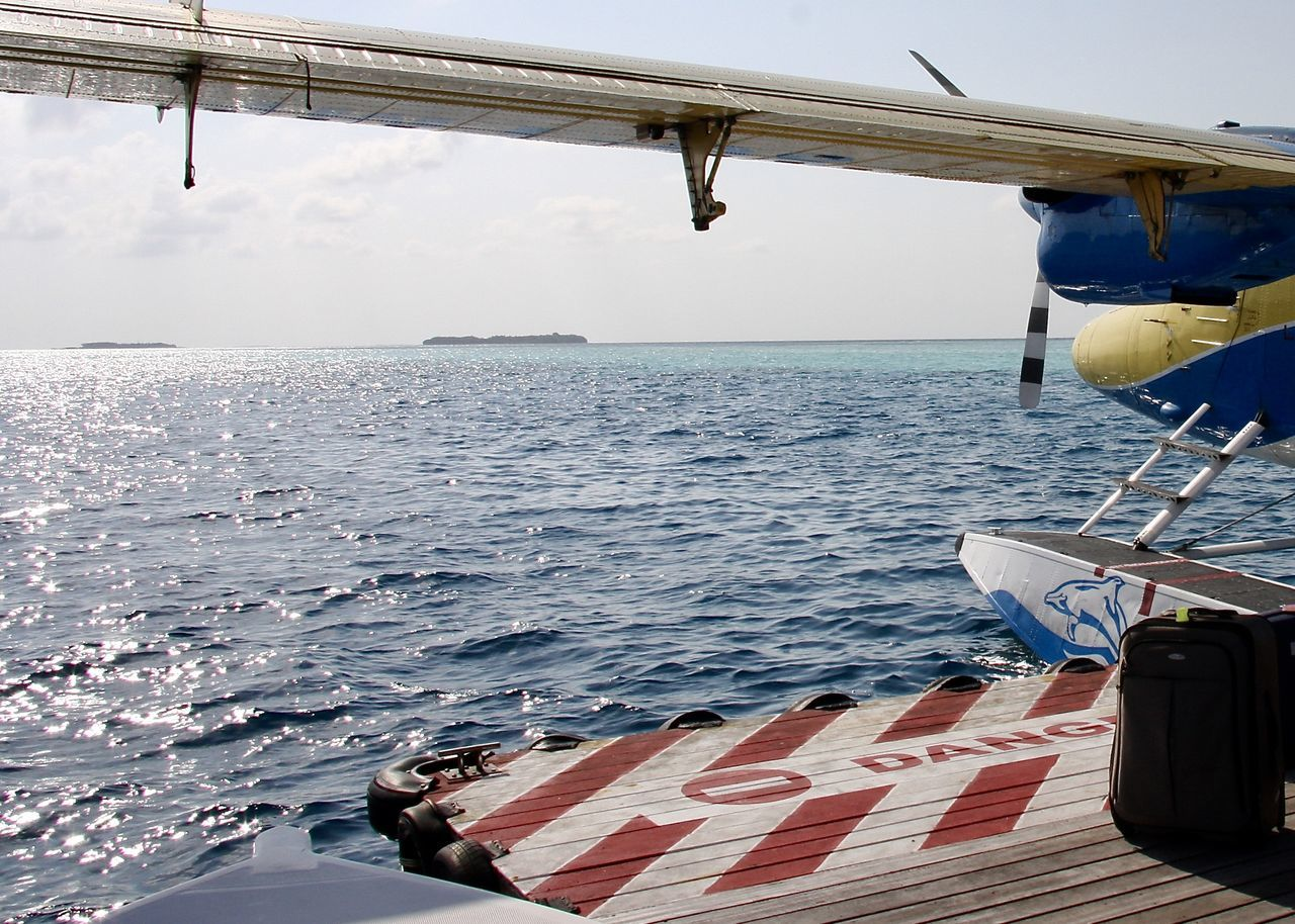Airplane floating on Indian Ocean , Maldives Air Vehicle Airplane Bag Boat Deck Colors Environment Floating Board Floating On Water Floatplane Horizon Over Water Island Light Maldives Nature Nautical Vessel Outdoors Sea Sky Sunshine Surface Technology Transportation Travel Water Wings