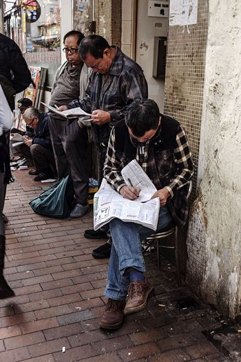 Afternoon read | Hongkong 2016 - Horse Race Betting Horse Race Betting HongKong Afternoon Read Newspaper Real People Only Men Outdoors People Lifestyles Visual Stories Visual Storytelling Street Photo Photography Streetphotography EyeEm Eyeem Philippines EyeEm Phillipines EyeEm HongKong Waiting