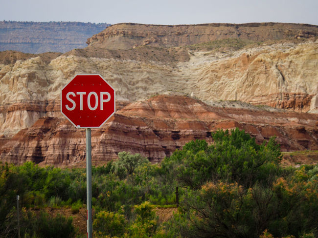 Arizona Canyons Desert Green Red Beauty In Nature Day Mountain Nature No People Road Sign Rock Formation Scenics Stop Stop Sign Text Tranquility