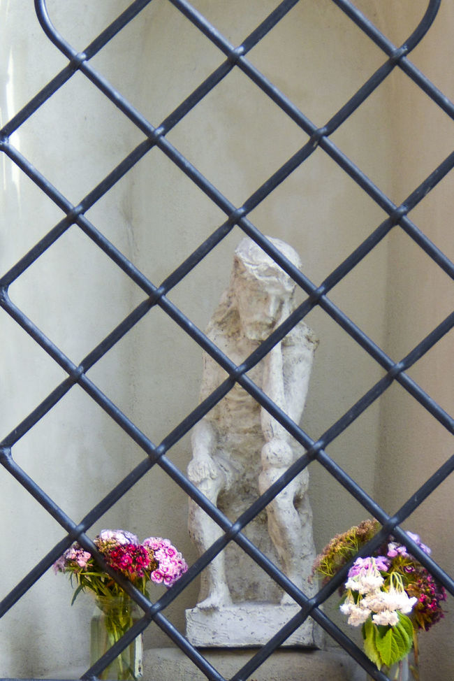 Bars Carving Castle Christian Contemplation Crisscross Fed Up FedUp Figure Flowers Holy Iron Bars Ironwork  Jesus Man Miniature Philosopher Shape Spiritual Squares Statue Suffering Thinker Vase White Walls