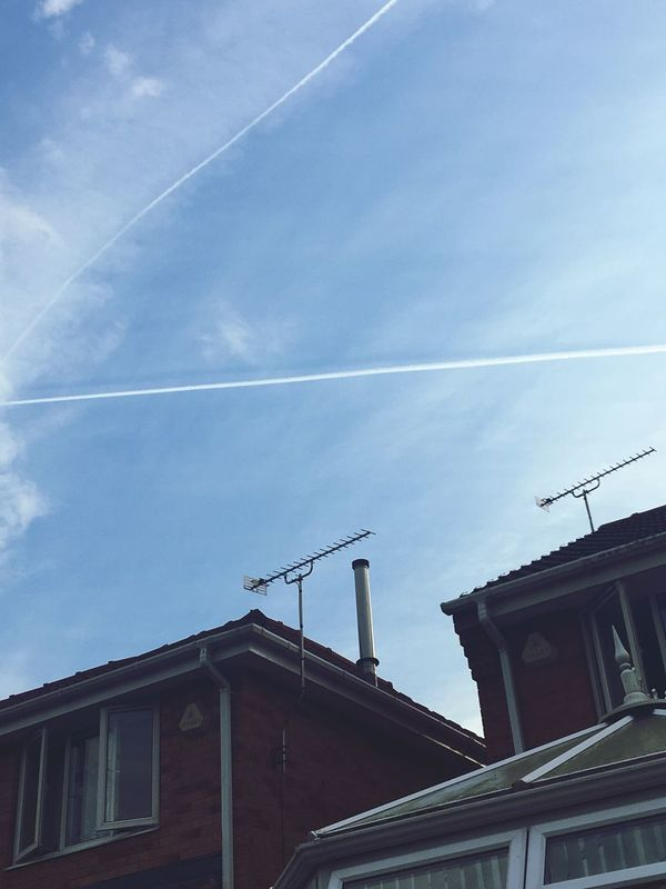 Low Angle View Building Exterior Vapor Trail Architecture Built Structure No People Sky Day Outdoors Contrail