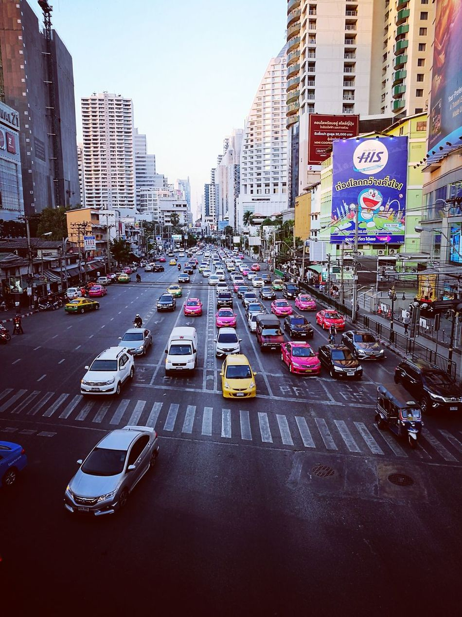 City Transportation Traffic City Street City Life Car Architecture Building Exterior High Angle View Urban Skyline Outdoors Road Cityscape Yellow Taxi Day Sky In The City Top Perspective Top Down View Top Down Traffic Jam In Bangkok Congestion Cars Street Photo
