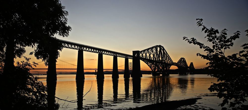 Forth Railway Bridge Atmospheric Bridge Distant Engineering Historic Iconic Light Outdoors Sea And Sky Silhouette Structure Sunset