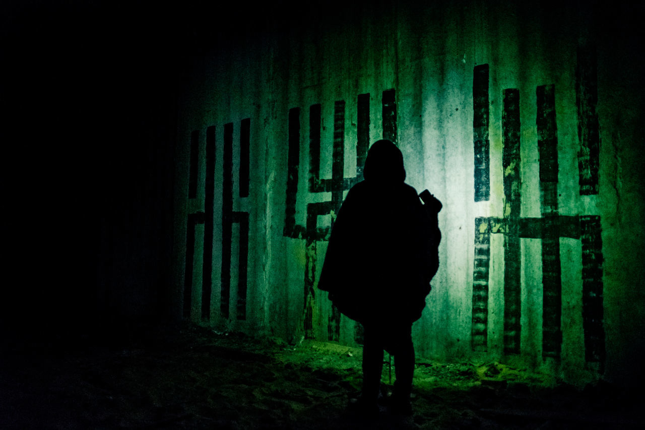 Occult rites in post-soviet Nuclear Command HQ Abandoned Abandoned Places Dark Darkness Flashlight Full Length Illuminated Indoors  Night Nuclear Occult One Person People Rear View Scenics Secluded  Silhouette Soviet Spooky Atmosphere Underground Urban Exploration War