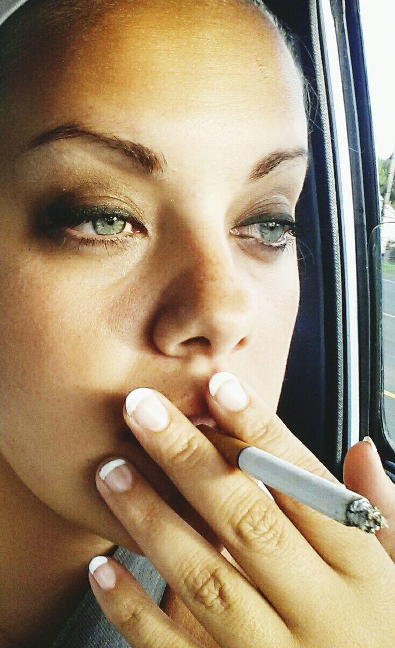 Close-up of a woman smoking