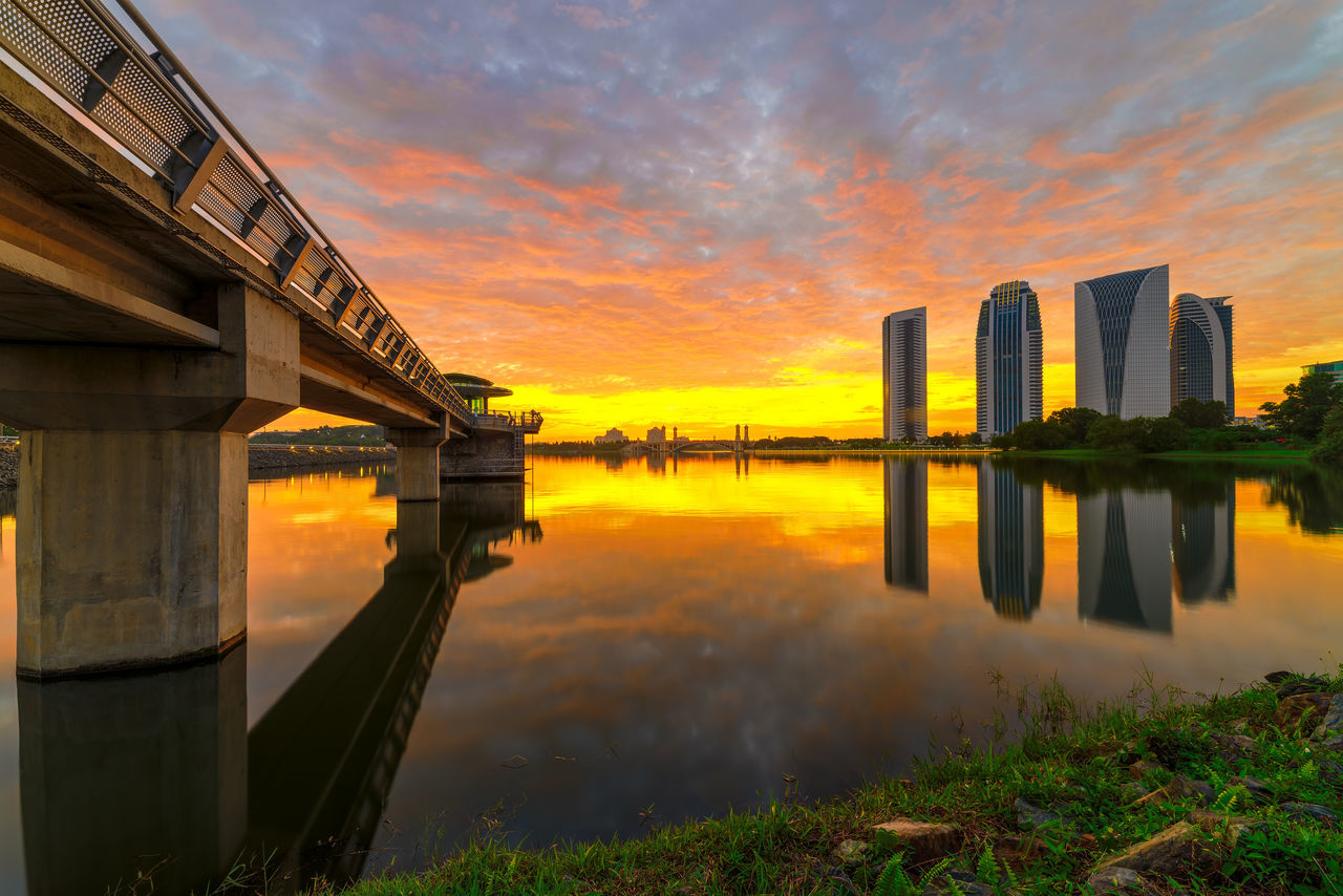 sunset, built structure, architecture, water, reflection, sky, orange color, building exterior, cloud - sky, outdoors, nature, no people, scenics, beauty in nature, day