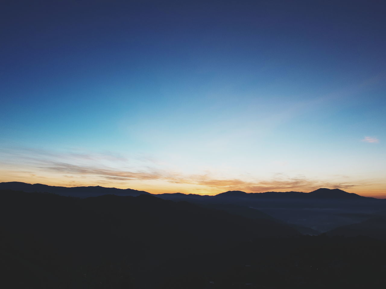 tranquil scene, beauty in nature, tranquility, scenics, nature, mountain, silhouette, copy space, sunset, blue, no people, mountain range, landscape, outdoors, sky, day