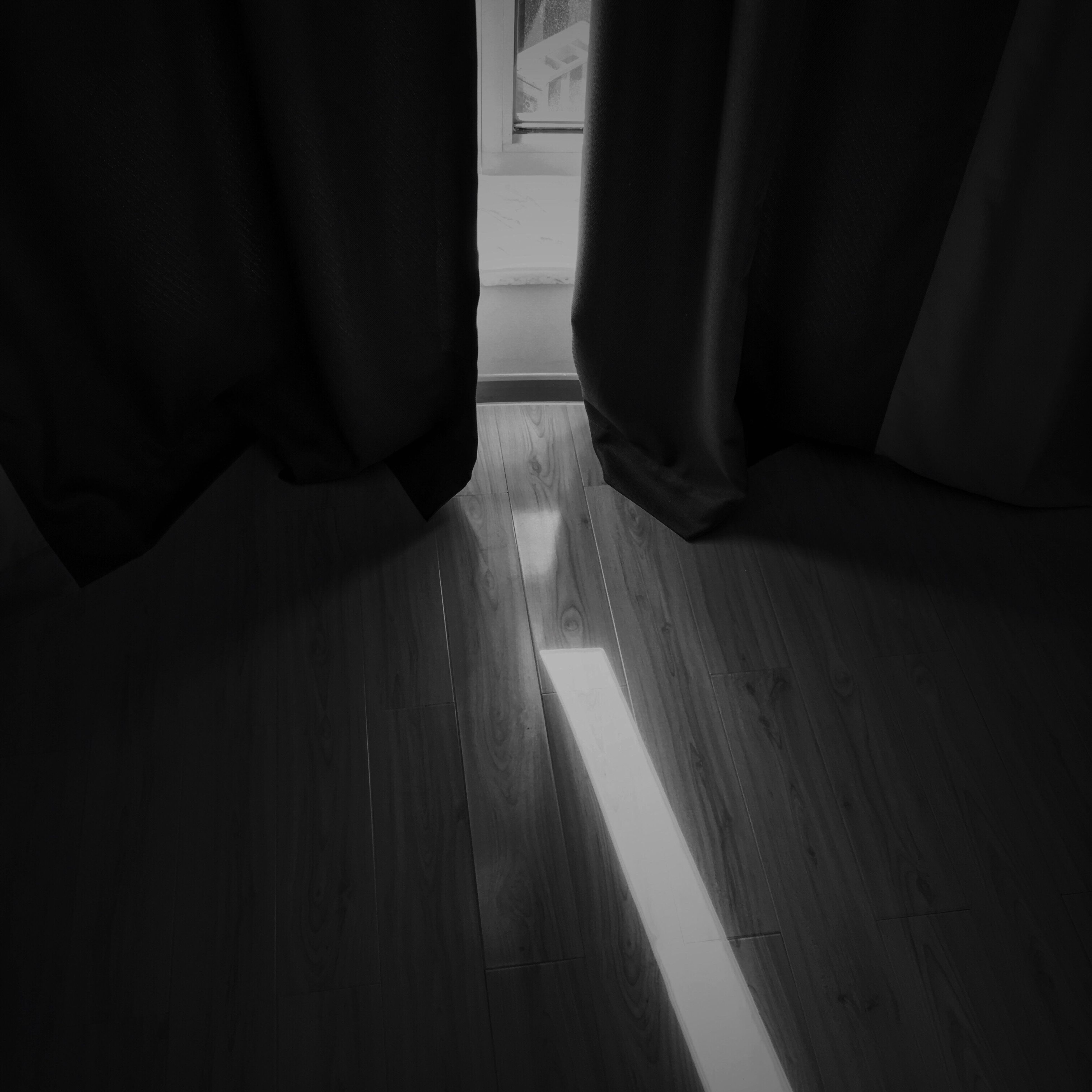 indoors, curtain, shadow, low section, window, sunlight, home interior, person, flooring, empty, relaxation, day, absence, dark, floor, domestic room, human foot, part of