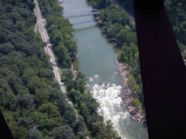 Those tiny dots in the river are rafts getting ready to hit the rapids Yikes! Way Too High Bridge Adventure West Virginia