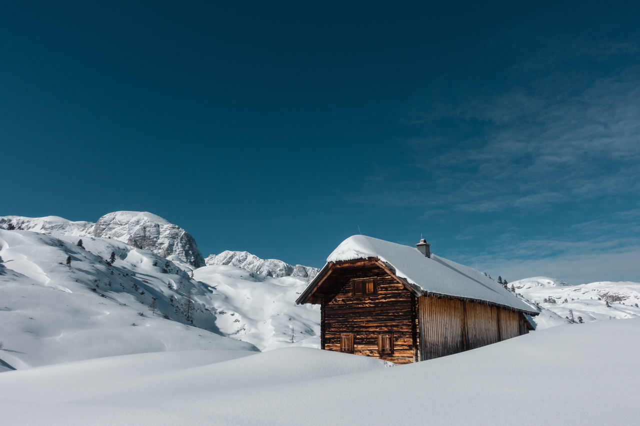 The Hut... Architecture Beauty In Nature Blue Built Structure Cold Temperature Day Hut Mountain Mountain Peak Nature No People Outdoors Scenics Sky Snow Snowcapped Mountain Travel Destinations Vacations White Color Winter Wood - Material