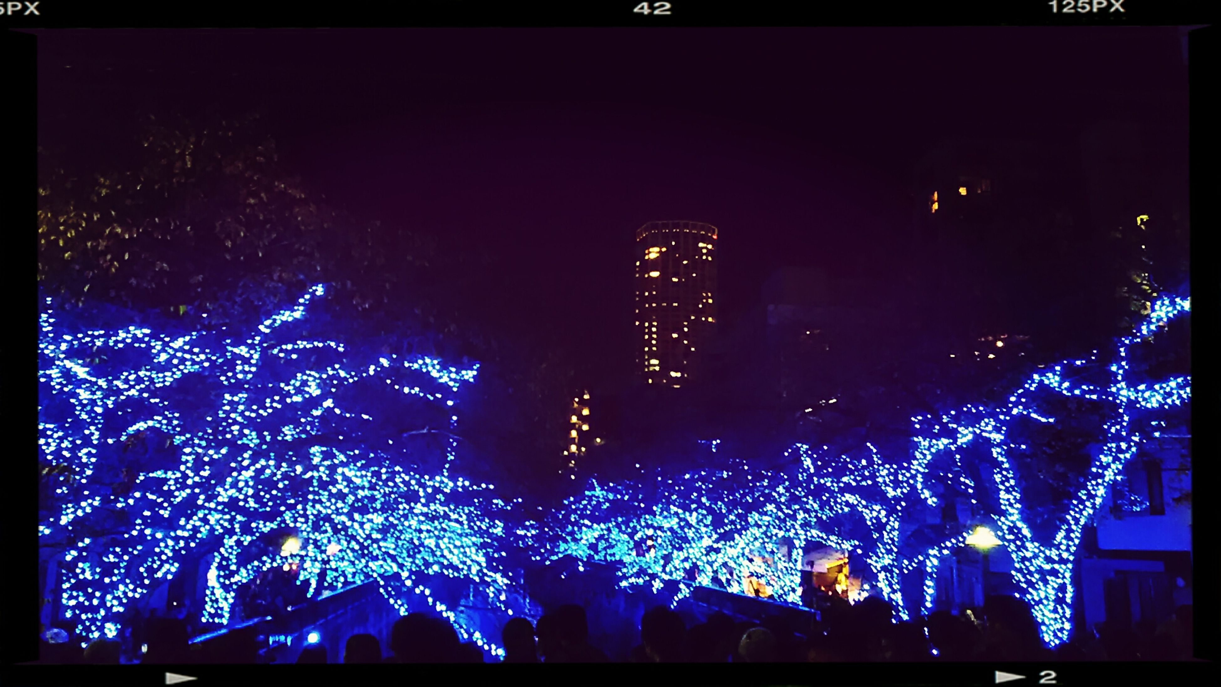 illuminated, night, large group of people, arts culture and entertainment, crowd, built structure, city, building exterior, event, celebration, architecture, lighting equipment, light - natural phenomenon, enjoyment, nightlife, leisure activity, city life, transfer print, sky